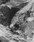 Ф. 36 Вид с левого борта на устьевой каньон ручья восточного склона пер.Чоттукай. Видна крутизна конгломератного склона под ногами фотографа. Отчет [5] 1988 г